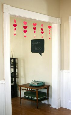 Really cute and easy Valentine decoration. You can substitute the hearts for other holiday shapes, too, like Christmas trees, birthday cakes, Valentine Valentine Day Love, Valentines Day Party, Valentine Day Crafts, Holiday Crafts, Valentine Ideas, Decoration St Valentin, Valentinstag Party, Happy Hearts Day, Heart Garland