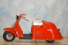 Vintage Cushman scooter.  My hubby had a black one in high school.