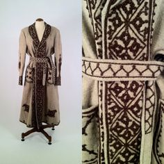 Vintage 1970s light and dark brown wool coat. Russian style with hand-knotted corded design. Deep front pockets and tie belt, this coat is partially