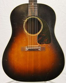 1951 Gibson J-45 in a no reserve auction. Seller puts this in Very Good condition with lots of small checks and scratches bit no breaks or repairs...