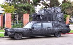 Carthedral - 1971 Cadillac hearse with VW Bug welded on top of it...looks like death on wheels. Made by Burning Man artist Rebecca Caldwell.