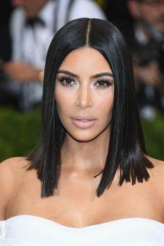 Kim Kardashian Medium Straight Cut - Kim Kardashian wore her hair down to her shoulders in a sleek straight style at the 2017 Met Gala.