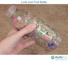 """Look and Find"" bottles are great entertainment for long car rides! They are simple to make and you can make them small or large depending on your needs. The concept is simple, fill a bottle with rice and place a bunch of small objects into the bottle too."
