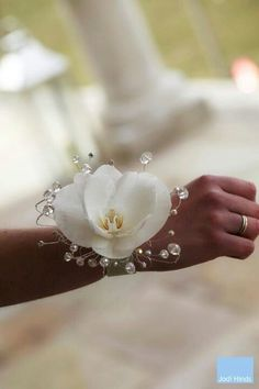 Pretty…simple orchid with lovely beading to surround it.