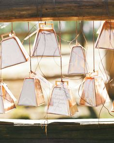 Let your seating cards serve as noisemakers and favors, too! These cowbells calligraphed with guests' names suited the couple's Wyoming wedding.