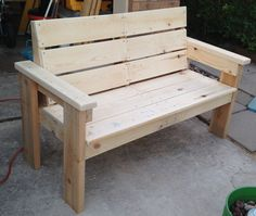 Pallet wood bench - My husband and I made this bench (our 4th) Oct. 30 2014 from wood from a great pallet and packing crate. We then painted it and delivered it to our neighbor, who is a vet with Parkinson's disease, so he can sit on it in his front yard.
