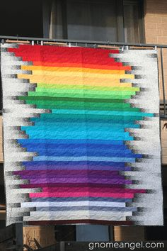 Super gorgeous Rainbow Stripe Quilt by Gnome Angel in Cannberra Australia. The variegated black and white fabric adds such dimension to this quilt! And the quilting looks amazing, too!