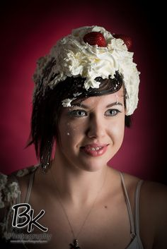 Portrait of a girl with whipped cream and strawberries on her head.  http://www.bkakronphotography.com/