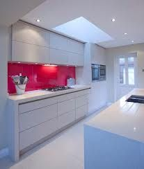 white kitchen with red splashback