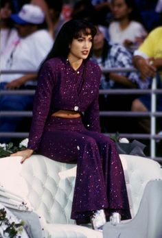 Selena Quintanilla was known for her unique stage costumes. Jennifer Lopez channeled the late singer in a purple sequin outfit featuring flared pants and a cropped jacket.