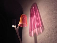"Martin Neuhaus has created this innovative lamp called ""becherlicht"" which throws a three dimensional colored shadow onto the wall."