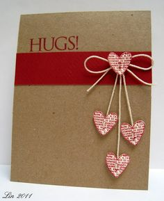"""We could make it say something other than """"Hugs"""" i like the bow and hanging hearts"""