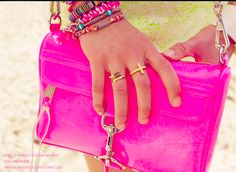 rebecca minkoff, hot pink mini mac; gold rangs; vanessa mooney, bracelets.