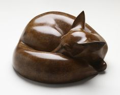 In this bronze sculpture, a Fox is portrayed as asleep in the woods or its earth. But is it really asleep? Its ears appear as if attuned to every sound. Again within such a simple form, a mood and sense of life is expressed. Released in an edition of twelve. Jonathan Knights.