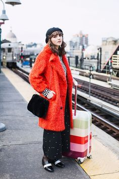 7 Looks That Are Inspiring Our Holiday Travel Wardrobe  #refinery29  http://www.refinery29.com/travel-style-street-stalking#slide-7  Opt For Statement OuterwearOften, the first travel tip we receive as kids is to wear our bulkiest item to save space in our suitcase. Take this one a step further by flaunting your fluffiest, most vibrant outerwear when en route. The bigger the better, as an oversize coat can do double duty as a cozy blanket.On Charlotte: Marimekko blouse, Behno pants, Uniqlo s...
