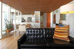 Pedigreed Midcentury Modern - WSJ House of the Day - WSJ.com    Love this home.  Great planter box by the window, orange door, artwork, ceiling, windows...