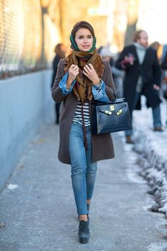 printed scarf, striped shirt, chambray shirt, brown coat, navy bag, blue jeans, teal platform booties