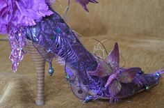 what a cool idea, take a pair of those obnoxious bridesmaids shoes and deck them out with beads,sequins and butterflies and turn them into fairy shoes!