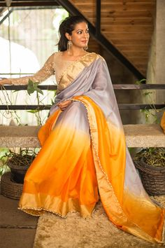Love pure silk but don't like the stiffness? Then this drape is made for you! A super soft drapey drape in pure silk coloured with a trendy grey to orange ombre effect. A silk saree never got cooler then this grab worthy drape.A fail proof orange blouse or a grey blouse. Or do as we do and add a textural gold blouse to up the stakes. #grey #orange #silk #saree #India #blouse #houseofblouse