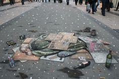 Julian Beever's amazing 3d pavement art.  The plight of the homeless.