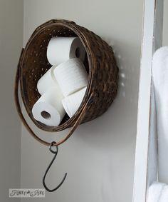 Basket toilet paper holder on wall / Salvaged farmhouse bathroom makeover via http://www.funkyjunkinteriors.net/