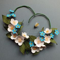 Quilled Jasmines and Forget Me Not Flowers in a Heart by Manu K