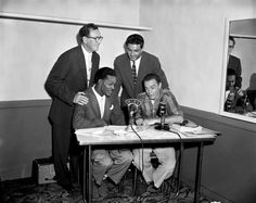 1955  As one of the pioneers of rock and roll, Berry took country and blues music and forged it into something new and different.  (Pictured) Disc jockey and promoter Alan Freed sits at a vintage microphone that reads WINS which is the call name for his NY radio station with rock and roll musician Chuck Berry and publisher Gene Goodman during a radio interview and broadcast on September 6, 1955 in New York, New York. /Michael Ochs Archives/Getty Images