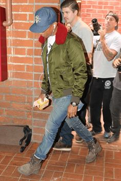 Pharrell Williams wearing Gucci Water Repellent Twill Nylon Jacket With Shearling Collar, Richard Mille Skull Chronograph Watch, Timberland 6'' Premium Boot, Billionaire Boys Club Icecream Cone