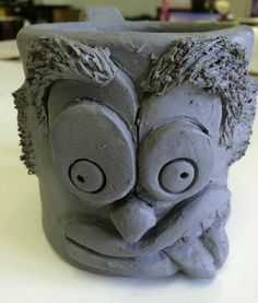 Funny Face Mugs Slab Construction Mug - Lesson 1. Use the slab construction method to create a mug with an expressive face sculpted onto it.