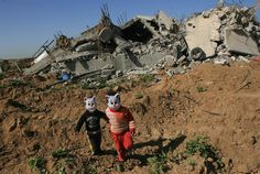 Children wear cat masks as they play near the rubble of destroyed homes in the neighborhood of Zeitoun in Gaza City in Occupied Palestinian Territory. The masks were distributed to children by the UNICEF-supported Palestinian Centre for Democracy and Conflict Resolution, a community-based local NGO. ---  © UNICEF/Iyad El Baba  http://www.unicef.org