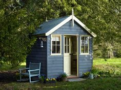 Slate blue shed pale yellow trim. Blue chair.