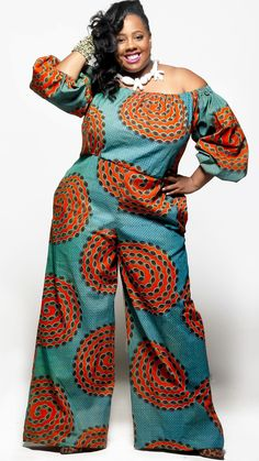 """Show a little shoulder in this African print off the shoulder jumpsuit. Wide legs and a fitted waist make this style universally flattering. 100% Cotton Sizes S-3XL Model is 5'9"""" and wearing size 2XL"""