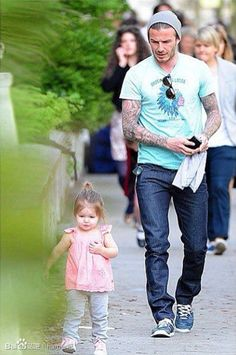I want a guy who has an accent, lots of tattoos and is a great father..wait I want David Beckham damnit