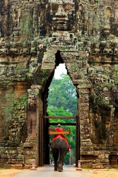 """Passing Through the South Gate of Angkor Thom (""""Great City""""), Siem Reap, Cambodia. Angkor Thom was the last and most enduring capital city of the Khmer empire. [http://en.wikipedia.org/wiki/Angkor_Thom] http://exploretraveler.com http://exploretraveler.net"""