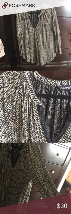 Peasant style black and cream blouse Beautiful casual black and cream blouse. Drapes beautifully. Stunning pattern. Beautiful details Lucky Brand Tops Blouses
