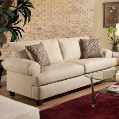 Refresh your living room or den with this chic buff-hued sofa. Made in the USA.  Product: Sofa Construction Materia...