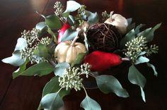 Easy Fall Centerpiece.  Seeded eucalyptus, white pumpkins, red pears & mercury glass. www.newgirlinthelou.wordpress.com