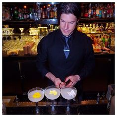 The final touches being added to three Lychee Martinis.