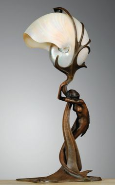 A NAUTILUS SHELL AND PATINATED BRONZE TABLE LAMP BY GUSTAV GURSCHNER, CIRCA 1899. SIGNED AND NUMBERED.