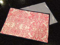 Great for Grandma's house, kid's table or eating out at restaurants with the baby.  Wipeable (laminated) Oilcloth Place mats in Pink Toile and Navy Blue Gingham  -- Set of 4. $28.00, via Etsy.