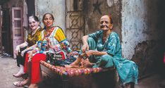Settling down for a tete a tete. — White Star | In the heart of Karachi, women rule the streets at night