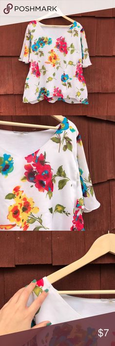 Bright Floral Flowy Blouse This blouse is a 1X so it can be worn as plus size, however I a typically a medium to large and I wore it with an oversized style. There is a small stain on the shoulder as picture, but it kind of blends into the pattern of the shirt. Tops Blouses