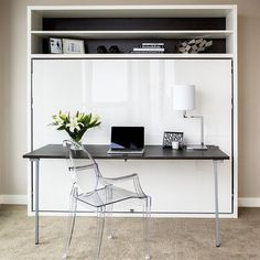 The Adam Tavolo is a horizontally opening, queen-sized space saving wall bed, with a desk and two shelves above the bed that run the length of the unit.