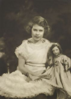 Princess Elizabeth with a Parisian doll, photographed by Marcus Adams. <br/> <br/>Royal Collection Trust / (C) Her Majesty Queen Elizabeth II . Margaret Rose, Princess Margaret, Royal Collection Trust, Isabel Ii, Queen Of England, Queen Mother, Prince And Princess, British Monarchy, Buckingham Palace
