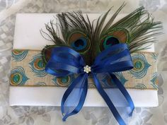 Check out this item in my Etsy shop https://www.etsy.com/listing/455414536/peacock-feathers-with-ribbon-burlap