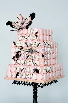 Stacked macaron cubes in lieu of a traditional cake.  Cute!
