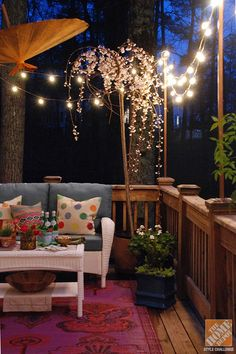 We love the way bistro lights give this comfy deck a warm glow!deck!