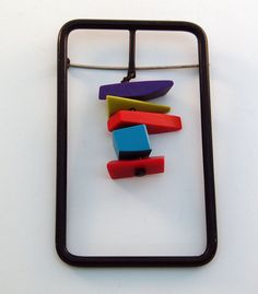 Geometric lucite & metal brooch by Martha Sturdy