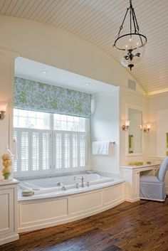 Jenny-Things I Love: Barrel Ceilings, wood floor and a beautiful chandelier in the bathroom