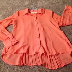 High/low coral blouse by Olive & Oak Coral is the color of this season. The pleats down the back are the eye catcher. High/low is the style. Olive & Oak Tops Blouses
